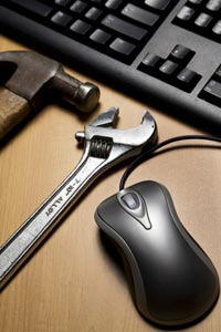 Picture of a hammer, wrench, mouse and keyboard